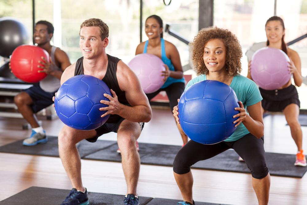 Multiethnic Gym Class Doing Squats Medicine Multiethnic Gym Class Doing Squats Medicine