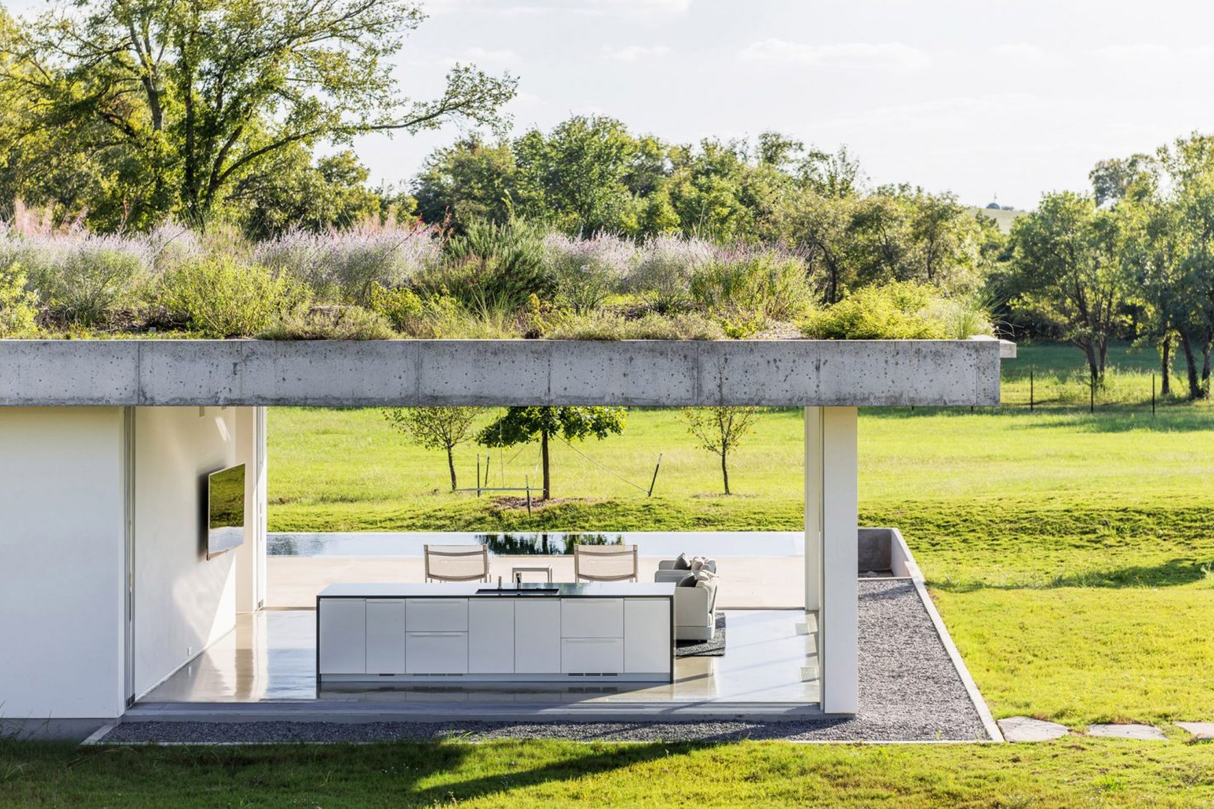 Best This Minimalist Pool House With Green Roof Is All About 400 x 300