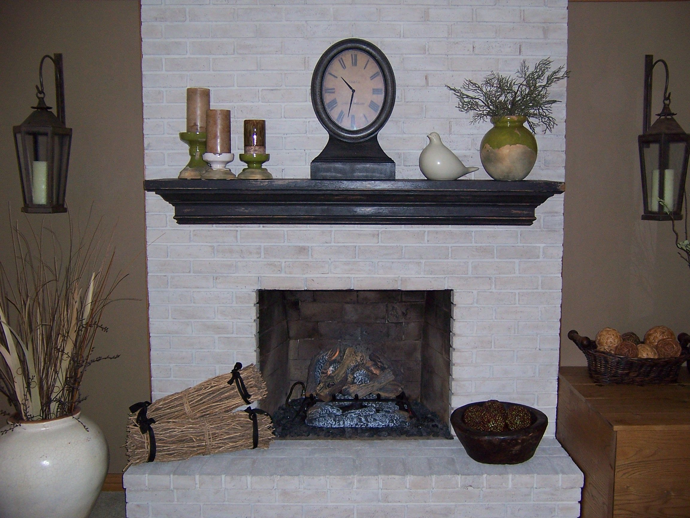 sandy caromal colours her tired brick fireplace… | brick fireplace