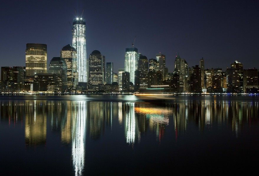 One World Trade Center towers above the Lower Manhattan skyline and Hudson River in New York City.