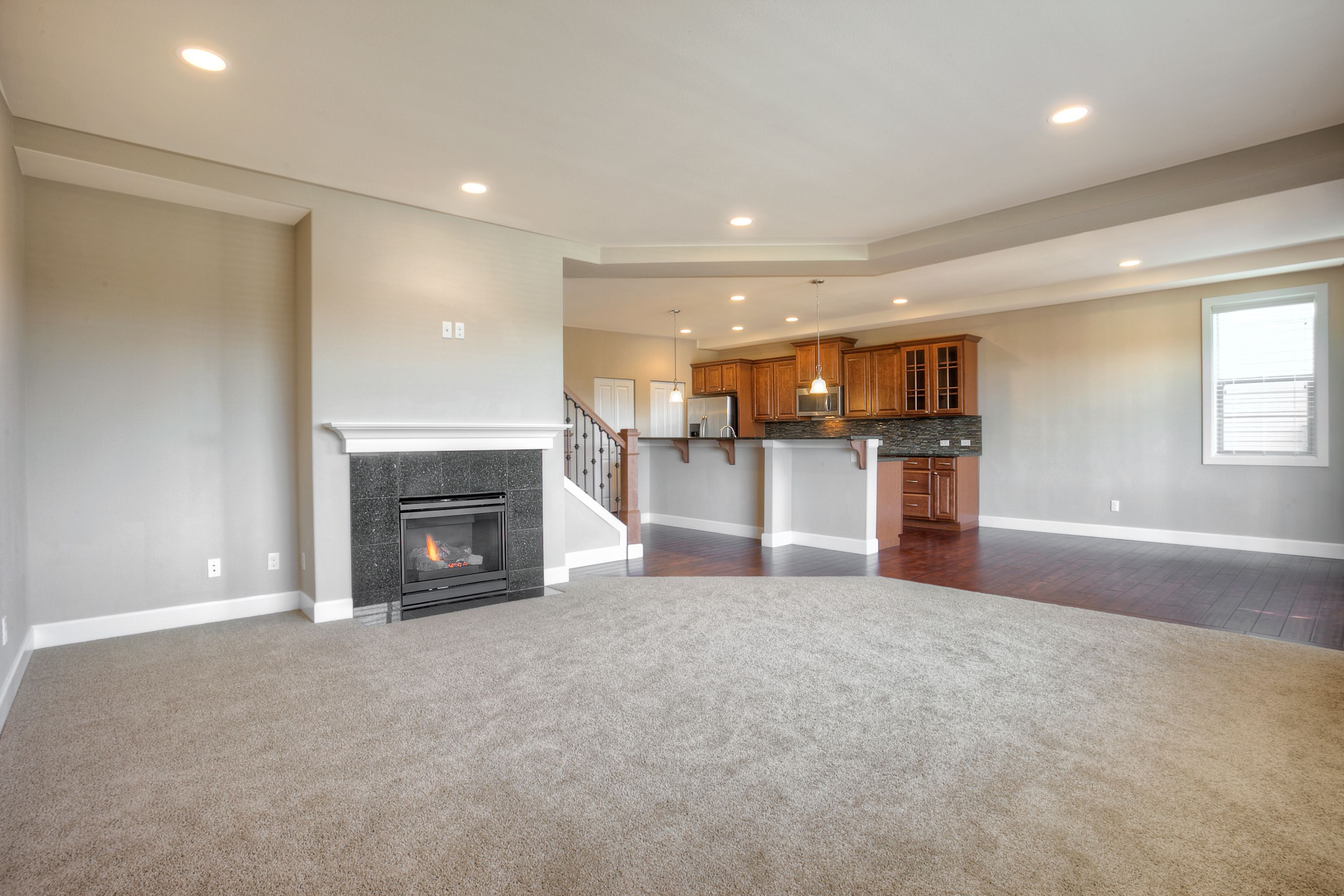 Gas Fireplace With Tile Surround And Mantle Beautiful Mohawk Carpets And Recessed Lighting New Homes For Sale New Homes Lennar