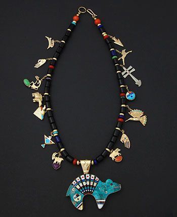 Reversible bear pendant and necklace in 14K and 18K gold, opal turquoise, jet, sugilite, coral, lapis, gaspeite and shell by Jesse Monongye (Navajo)