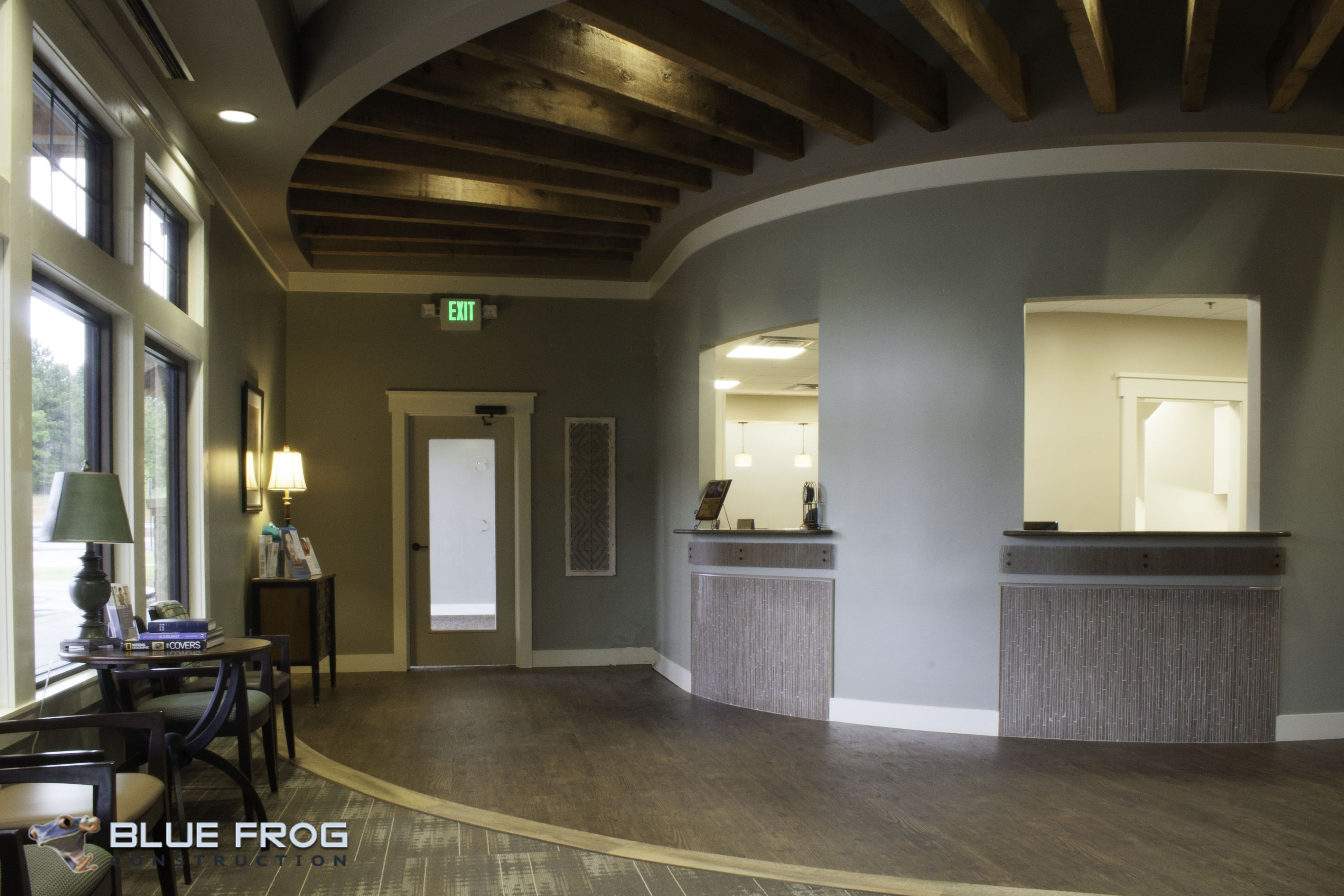 Dermatology Clinic Asc Check In Area With Cedar Beams Above By Bluefrog Design Build Firm