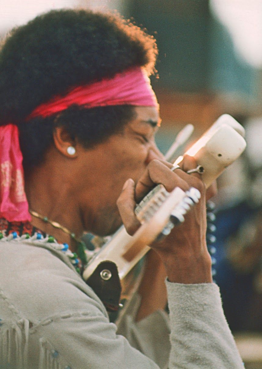 Jimi Hendrix Playing His Stratocaster With Teeth At Woodstock