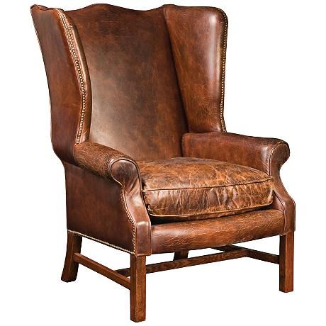 A Handsome Wingback Arm Chair With Cigar Brown Top Grain