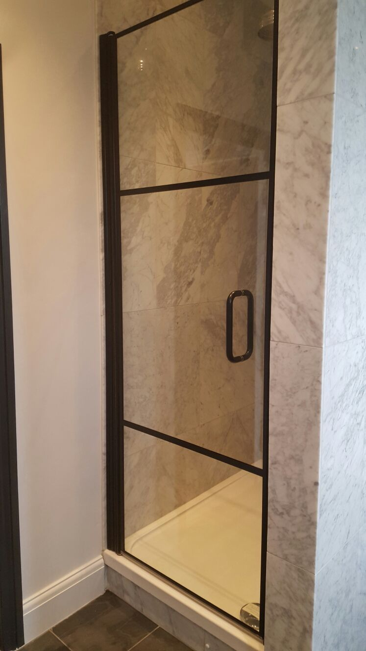 A Very Simple Black Framed Shower Door Used In This Enclosure