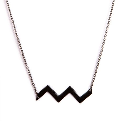 Love this Black Enamel Chevron Necklace! Edgy but fun. Available now at Poketo. // $27