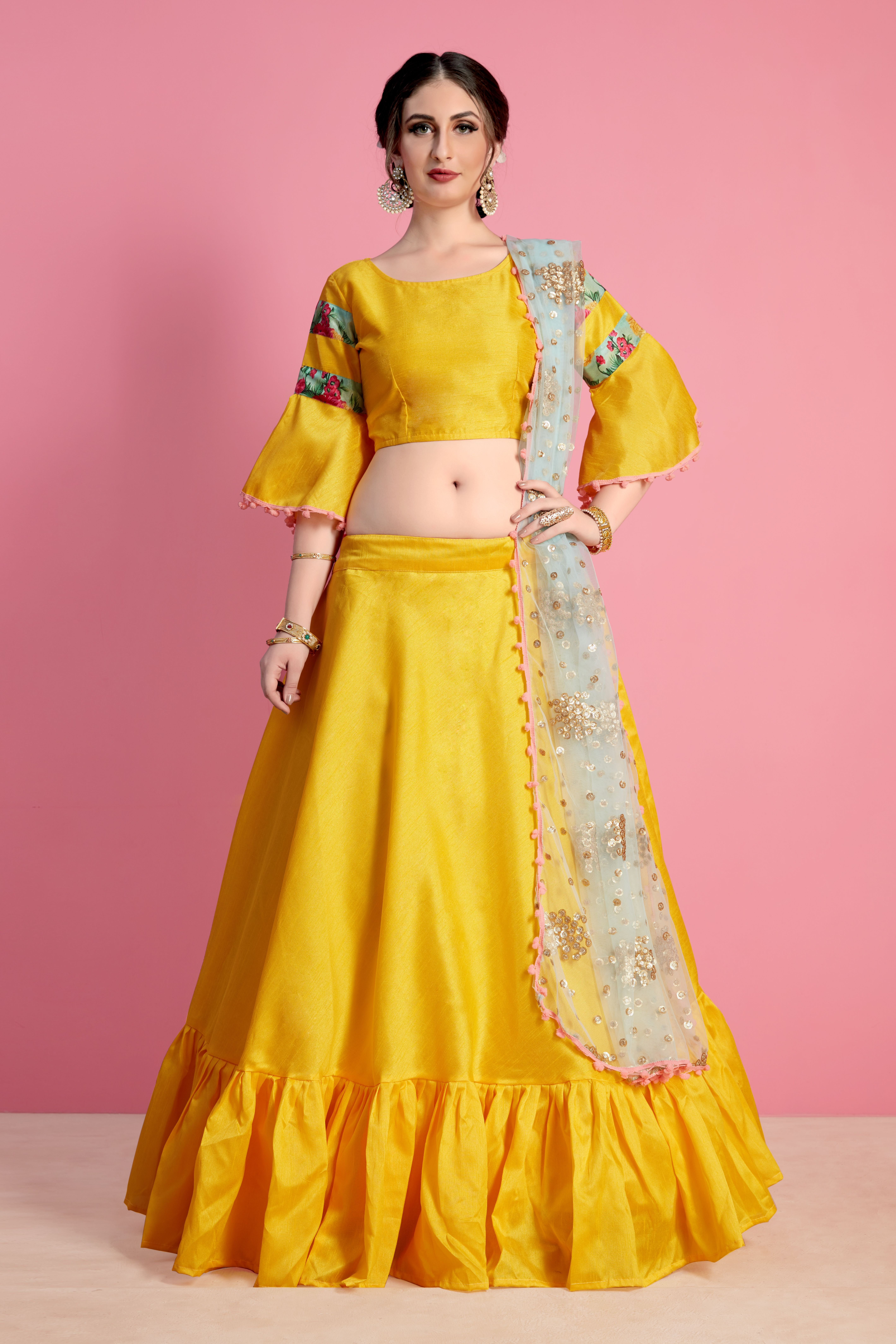 d878788d24e4d Outstanding craftmanship of embellishments exhibited in this yellow art silk  lehenga choli.