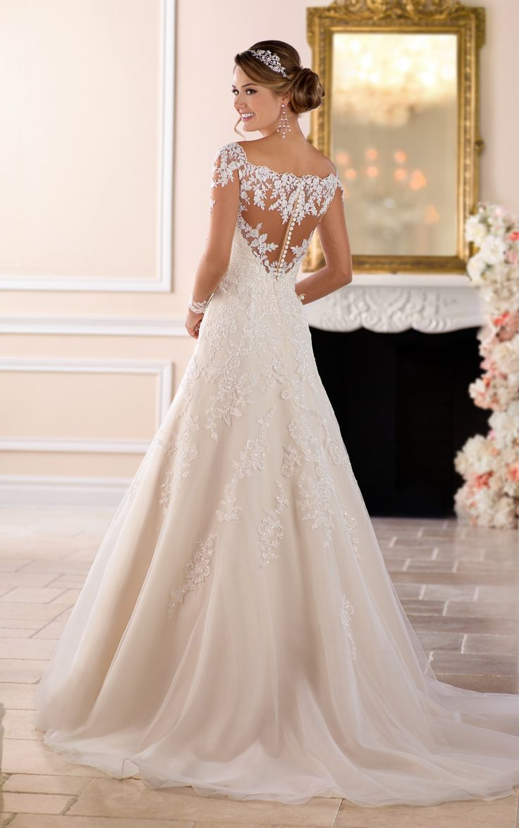 From Stella York, this off-the-shoulder lace wedding dress with