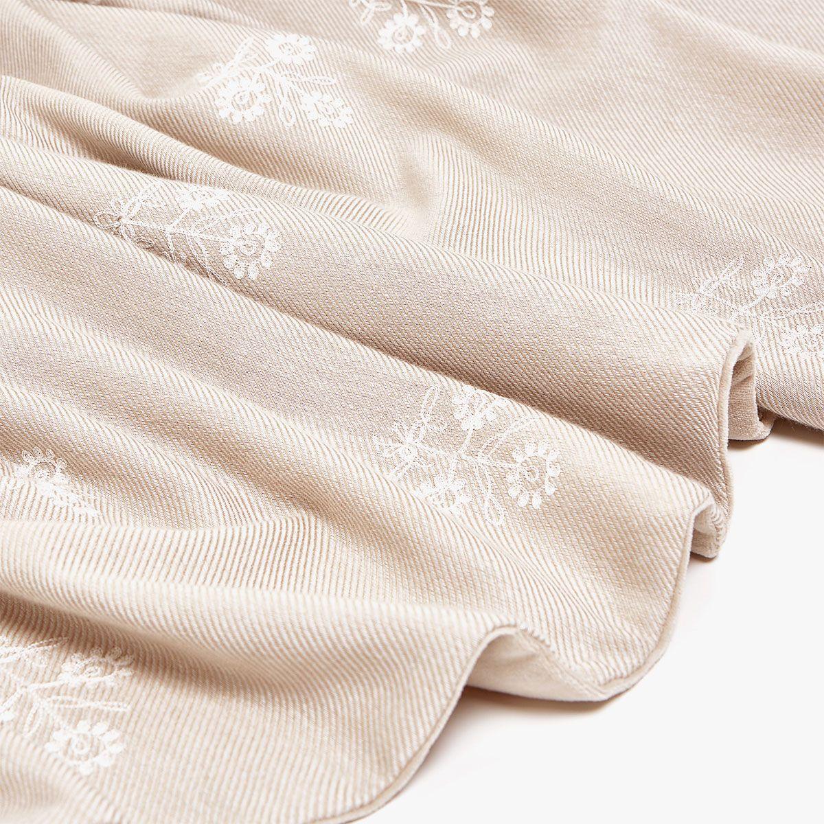 Embroidered bedspread with velvetcovered tassels Bedspread