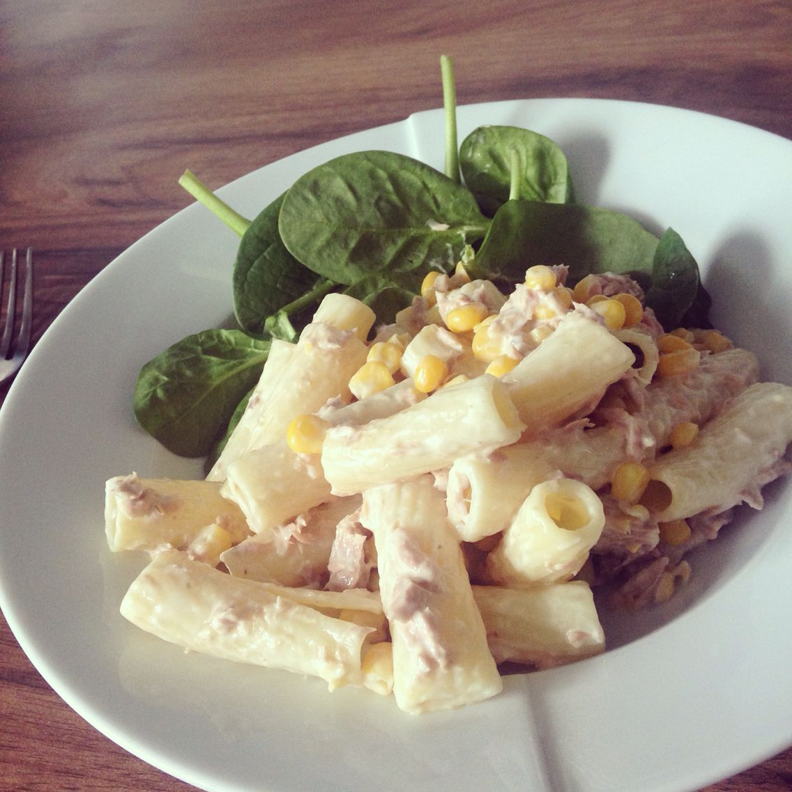 Four ingredient pasta salad - pasta, tuna, sweet corn and extra light mayo - simples :) served with spinach leaves