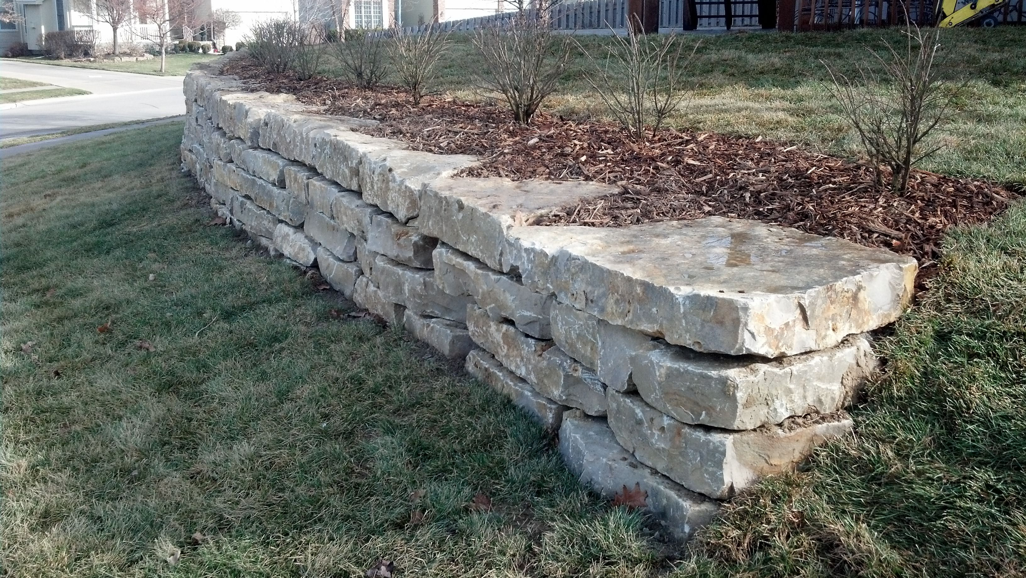 Limestone Retaining Wall Mechaley Landscaping Natural Landscaping Outdoor Gardens Pebble Patio