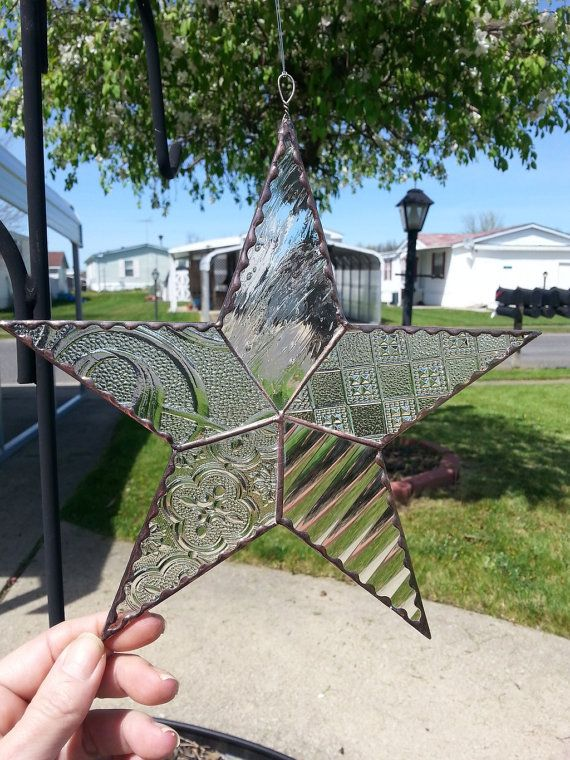 This stained glass star was created using 5 types of clear textured new and vintage glass, and constructed in the Tiffany method of copper foil