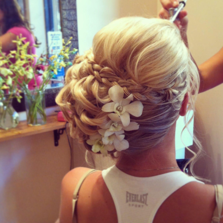 Bridal updo Side chignon with braid Facebook.com/sugarandspiceartistry