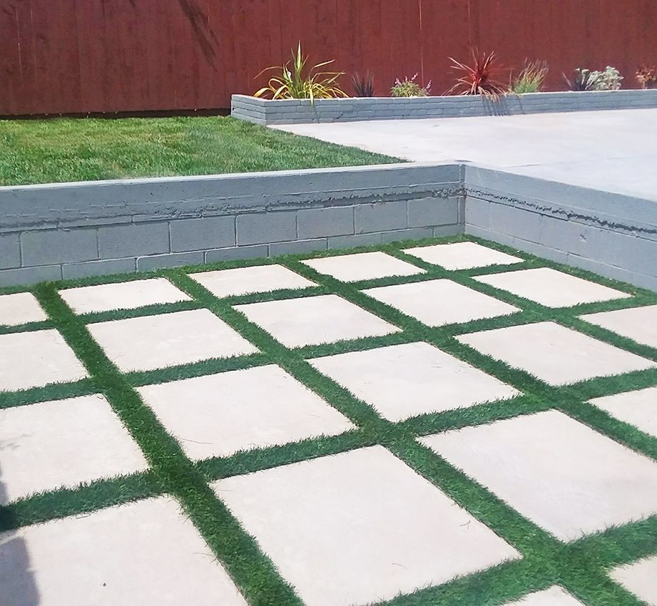 Concrete Pavers With Artificial Turf Work Well As A Patio