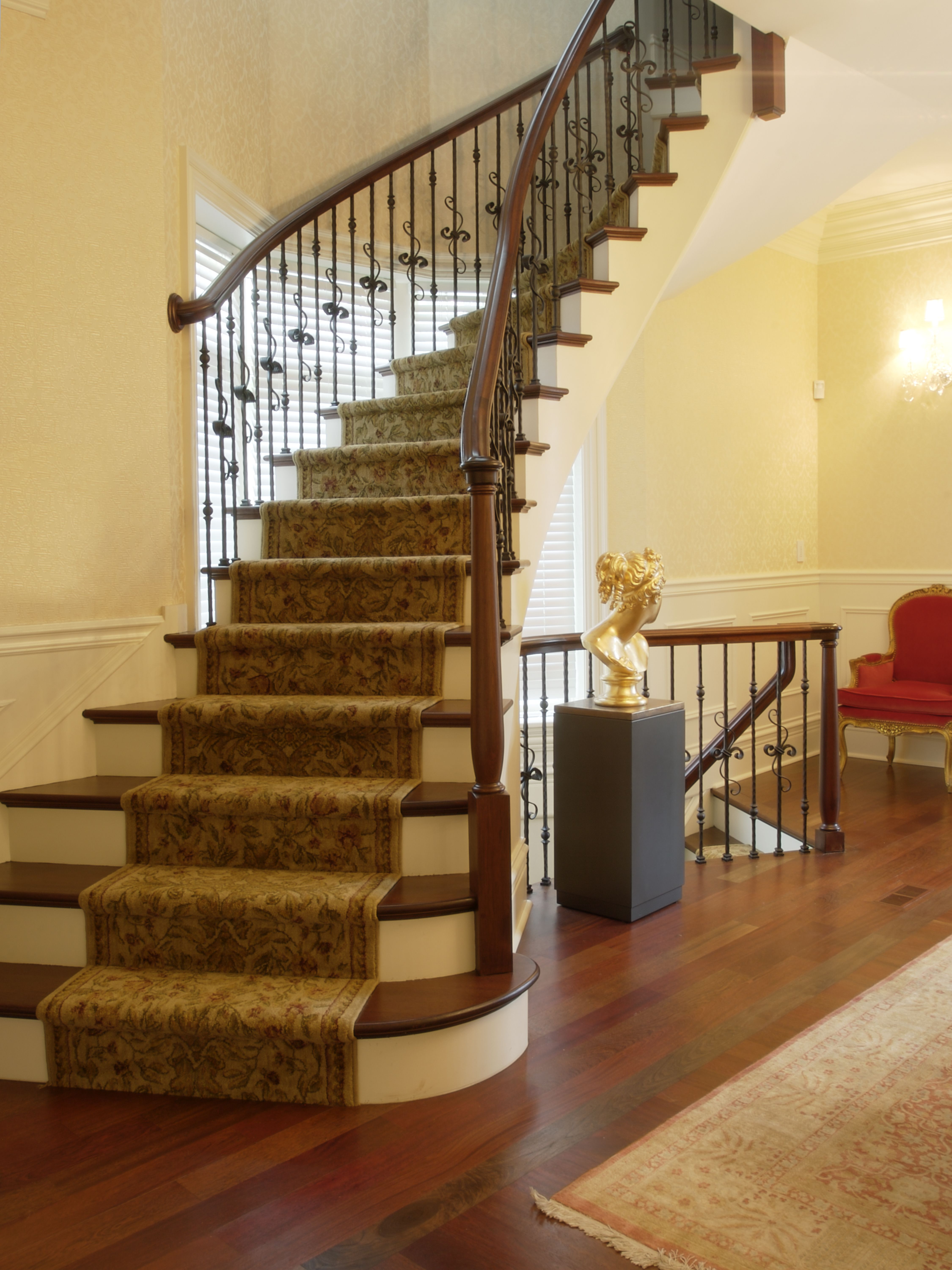 lg construction + development arched stairway | heart of the home