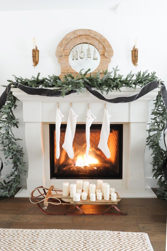 limestone look fireplace mantel with stockings and garland everything christmas pinterest fireplace mantel mantels and garlands - Decorating Fireplace Mantels For Christmas Pinterest