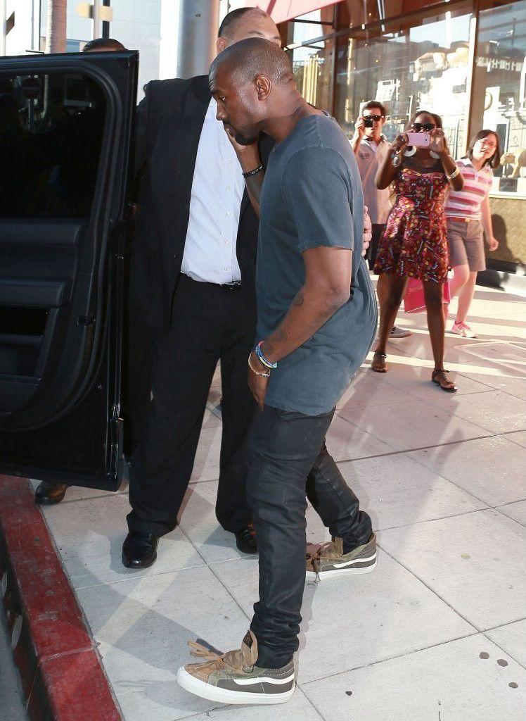 d7f492b6a6 Kanye West wearing WTAPS x Vans Vault Sk8-Hi Olive (4)