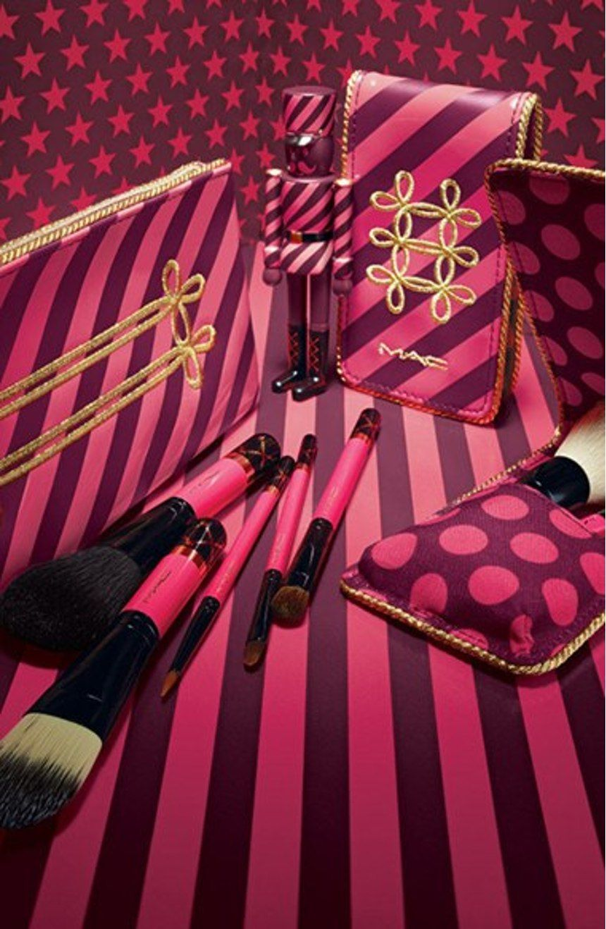 These everyday brushes feature fuchsia handles and gold accents and come presented with a matching fuchsia and burgundy striped pouch.