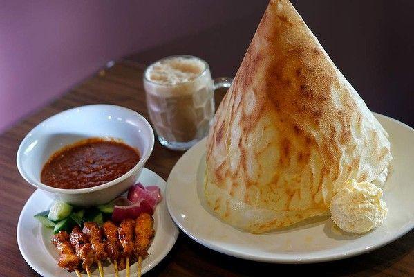 Award winning Melbourne restaurant - cheap eats! Mamak's roti tisu with chicken satay and teh tarik.