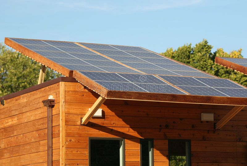 Solar Panels On Eco House Roof Roof Mounted Solar Panels On An Eco Friendly Woo Aff House Roof Mounted Solar Pa With Images House Roof Eco House Solar Panels