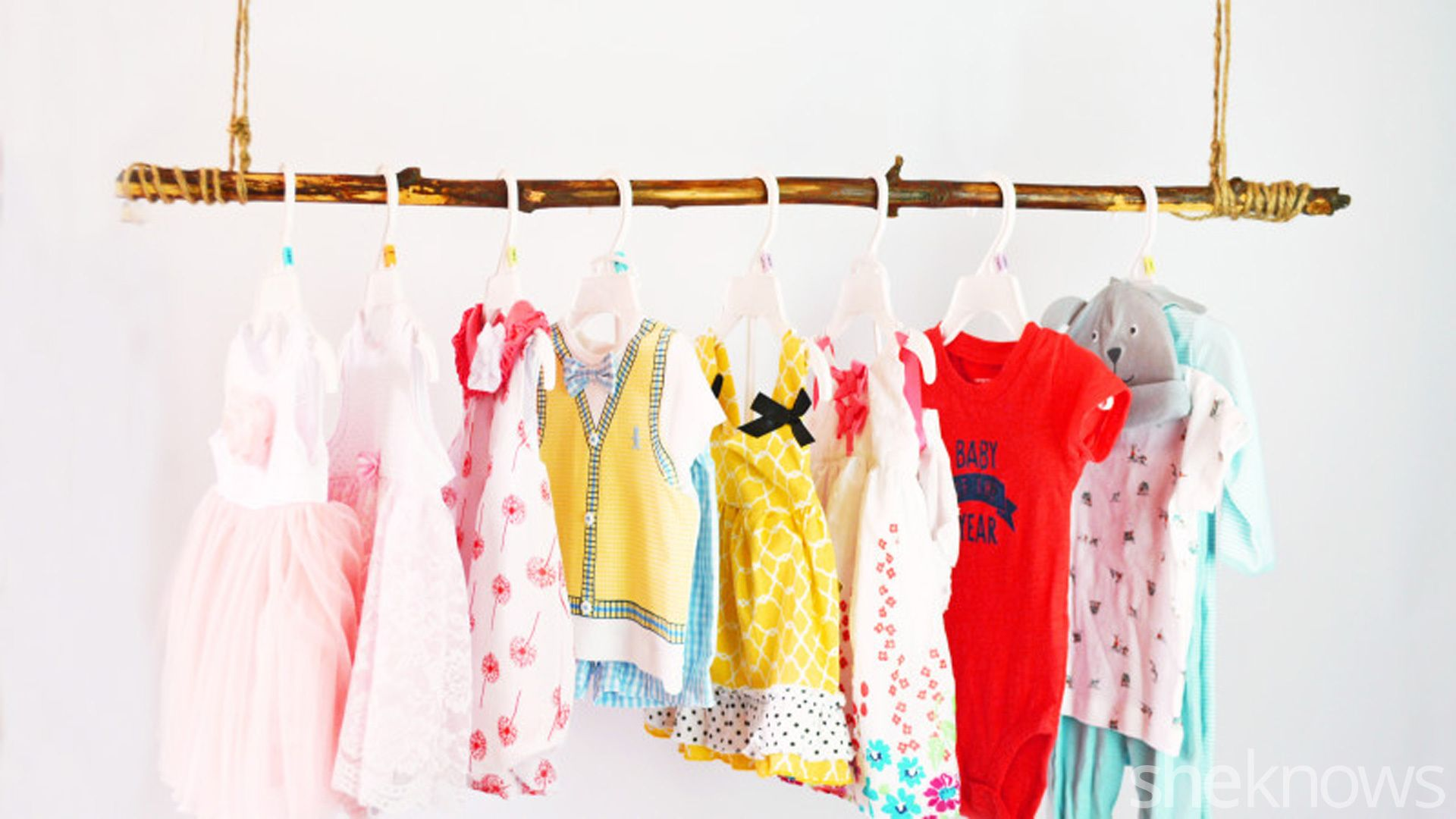 A Hanging Clothing Rod Makes It Easy To Display (And