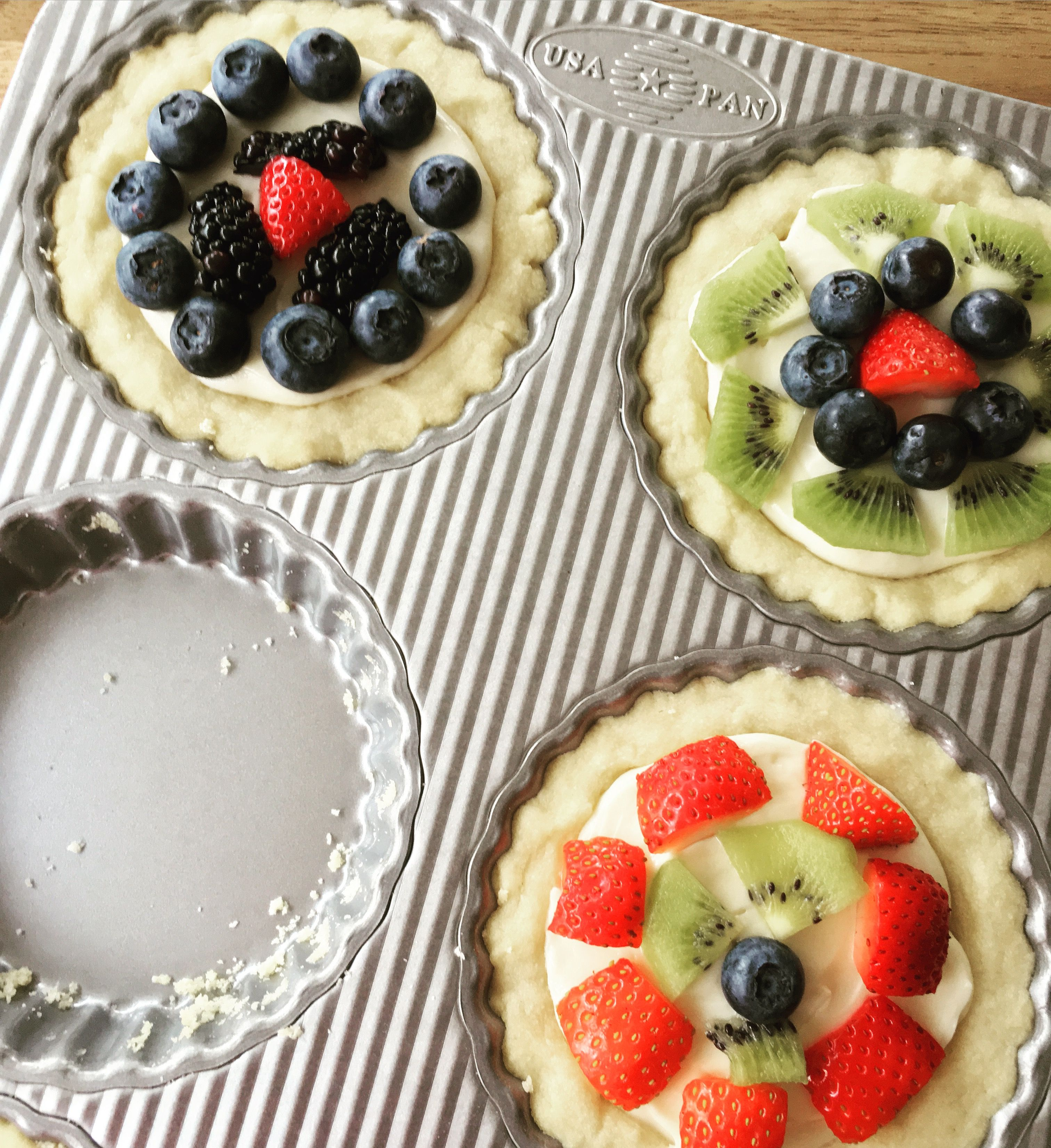 Fresh fruit mini tarts baked in our usa pan mini fluted