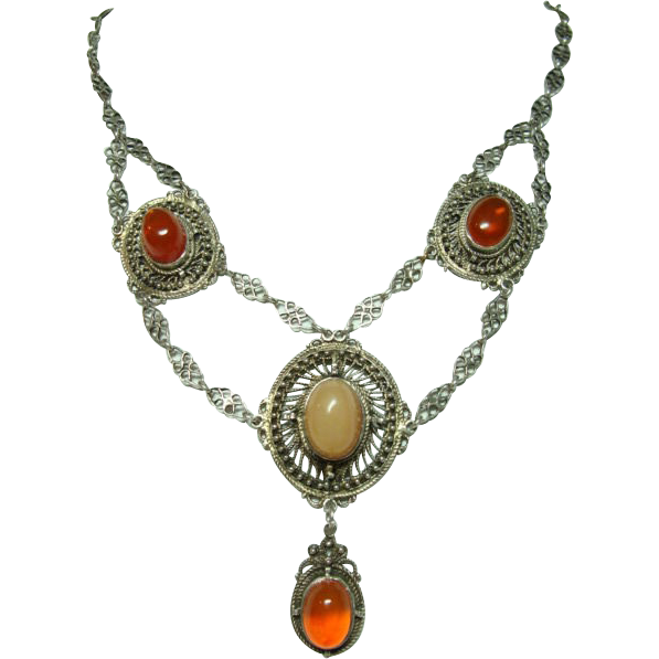 From White Peacock Jewels on Ruby Lane.  Mexican Opal Antique Festoon Necklace