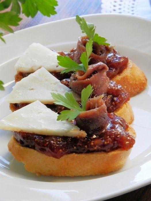 TAPAS. FIG JELLY, ANCHOVY AND SHEEP CHEESE. Montaditos de mermelada de higo, anchoa y queso de oveja curado
