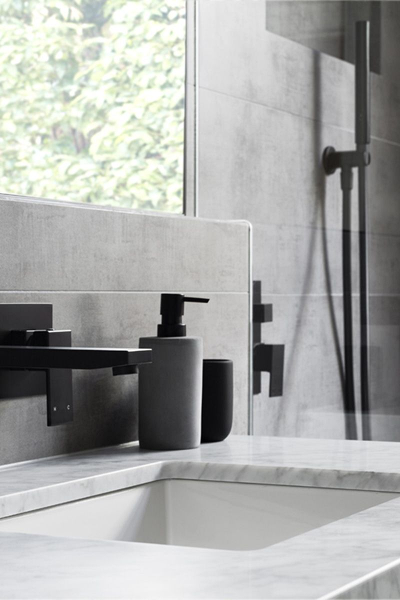 In This Modern Grey And White Bathroom Matte Black Accents Like Soap Pumps Hardware
