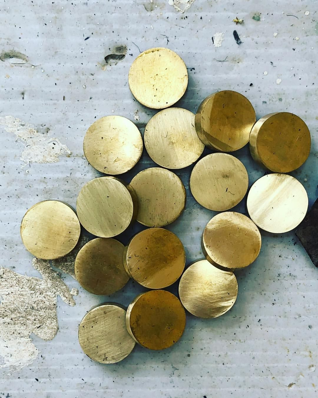 A half set of cast brass BACKGAMMON checkers ready for