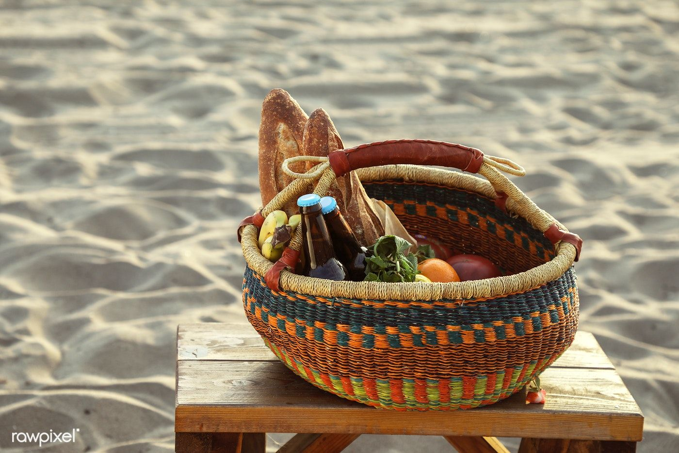 Picnic Basket Filled With Snacks And Drinks At The Beach Free
