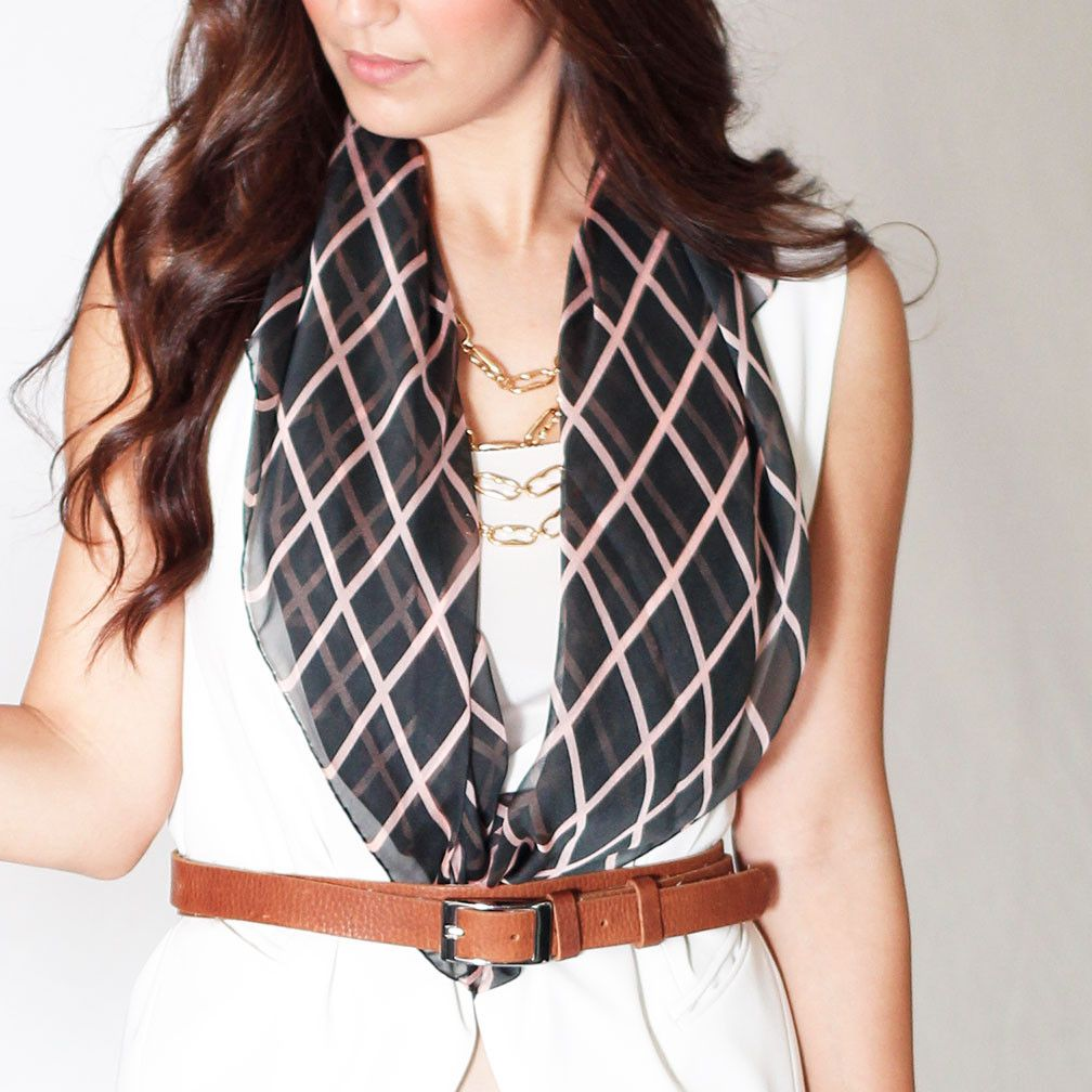 The Charlie - Pink & Graphite Checkers.  http://www.terracottanewyork.com/collections/scarves/products/the-charlie-pink-graphite-checkers.  Also remember to LIKE us on facebook at www.facebook.com/terracottanewyork.  Modeled by Vanessa Balli www.vanessaballi.com.