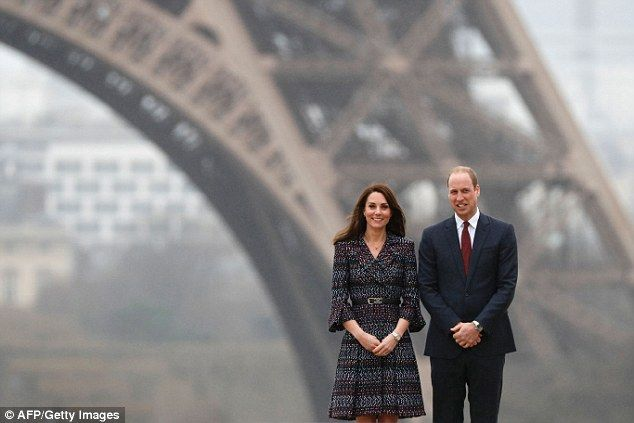 Prince William and wife Kate, Duchess of Cambridge, pose in front of the Eiffel Tower duri...