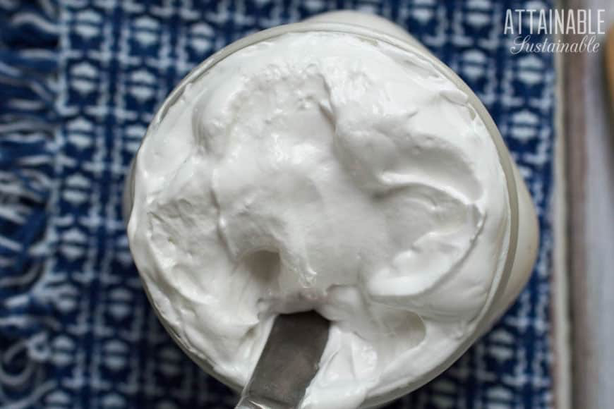 This homemade marshmallow fluff recipe is so easy, you'll never buy the jars of fluff again and it has none of the wonky marshmallow fluff ingredients that come with store-bought. Learn how to make marshmallow fluff at home and you can cut out the GMO ingredients in your sweet desserts. #christmas #recipe #sweets #homemademarshmallowfluff