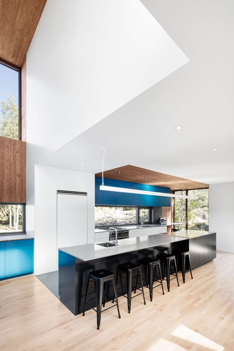 love this modern white, wood, black, and blue kitchen. outdoors in ...