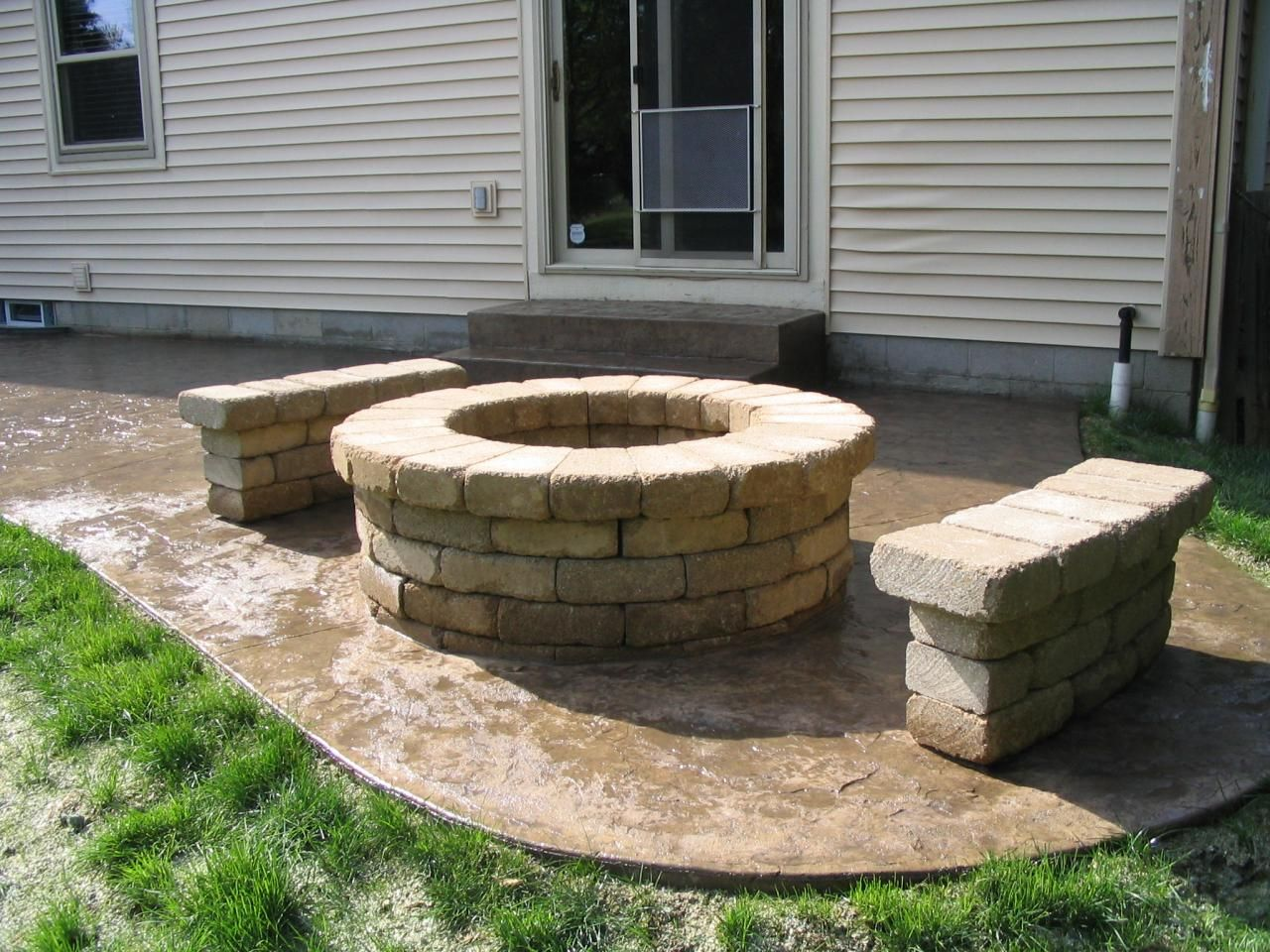 Textured Skin Stamped Concrete With Fire Pit And Wall Seating