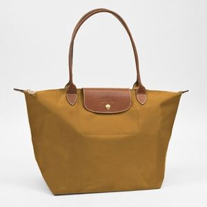 hunter green color not this color. Want monogram embossed in gold on the leather flap.