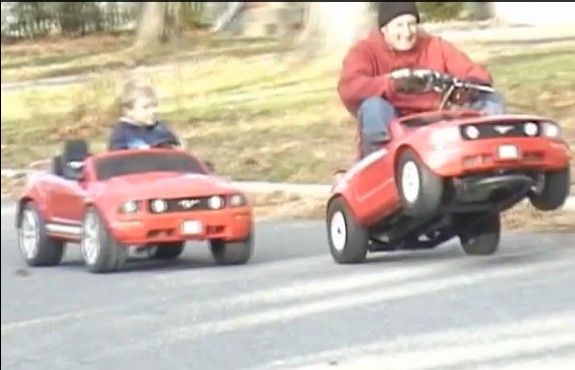 gas powered powerwheels mustang vs stock electric mustang racing these 2 powerwheels mustangs one h