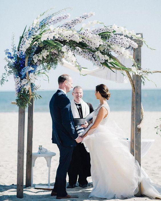 Simple Beach Wedding Ideas: Beach Wedding Ceremony Arch With Delphiniums And Gladiolas