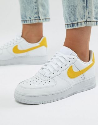 timeless design 16f86 29fdd Nike Air Force 1 Trainers In White And Yellow