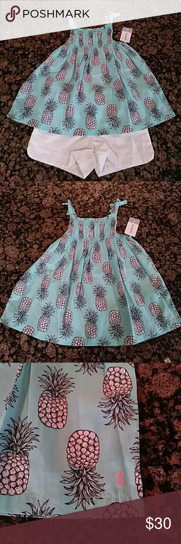 Pineapple Top & Shorts Set Pineapple smocked tank top and shorts set size - 6. Smocked pineapple print tank with white shorts that have a drawstring. Such a beautiful color and print! Carter's Matching Sets