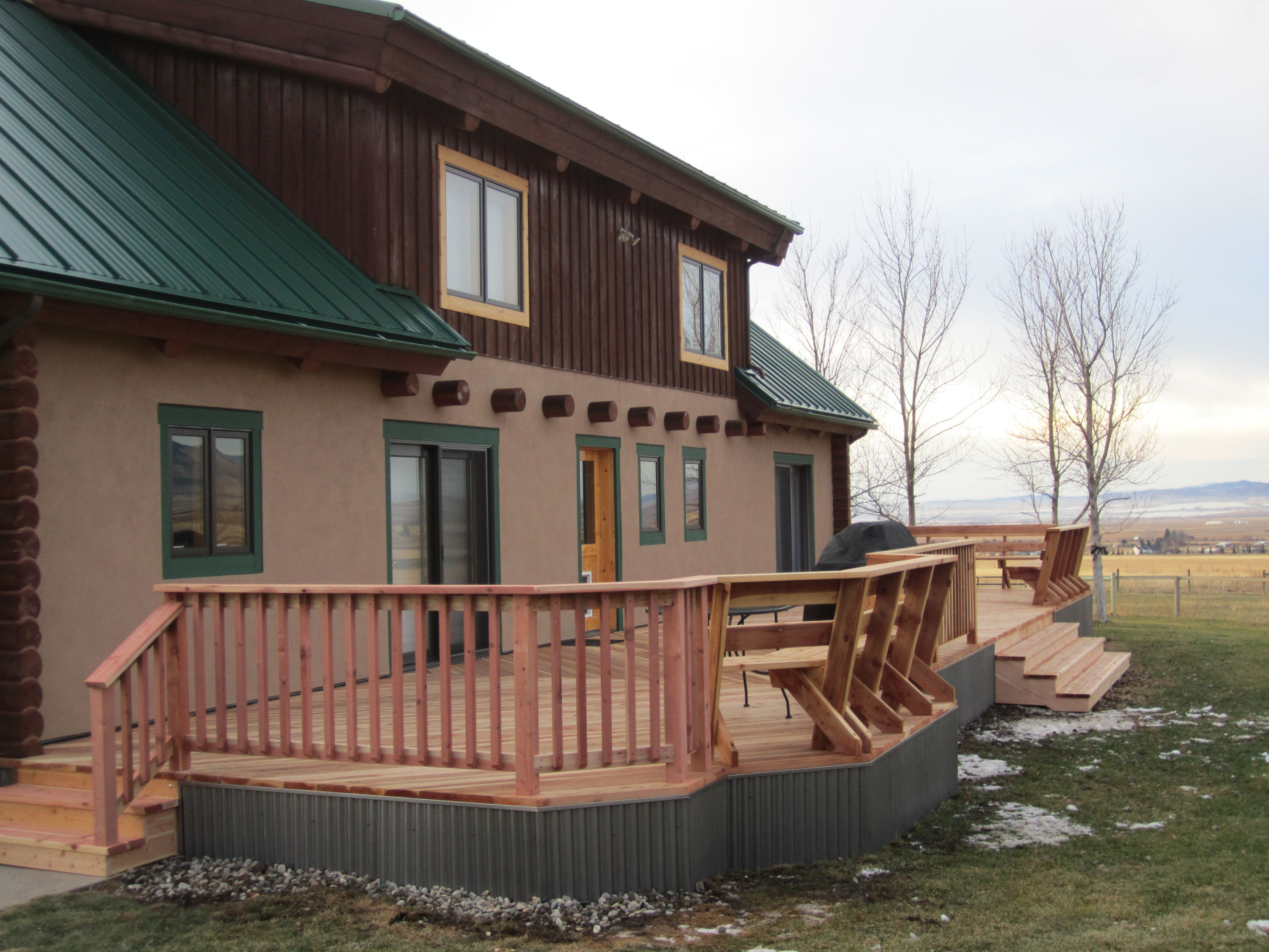 Redwood Deck With Corrugated Steel Skirt And Built In