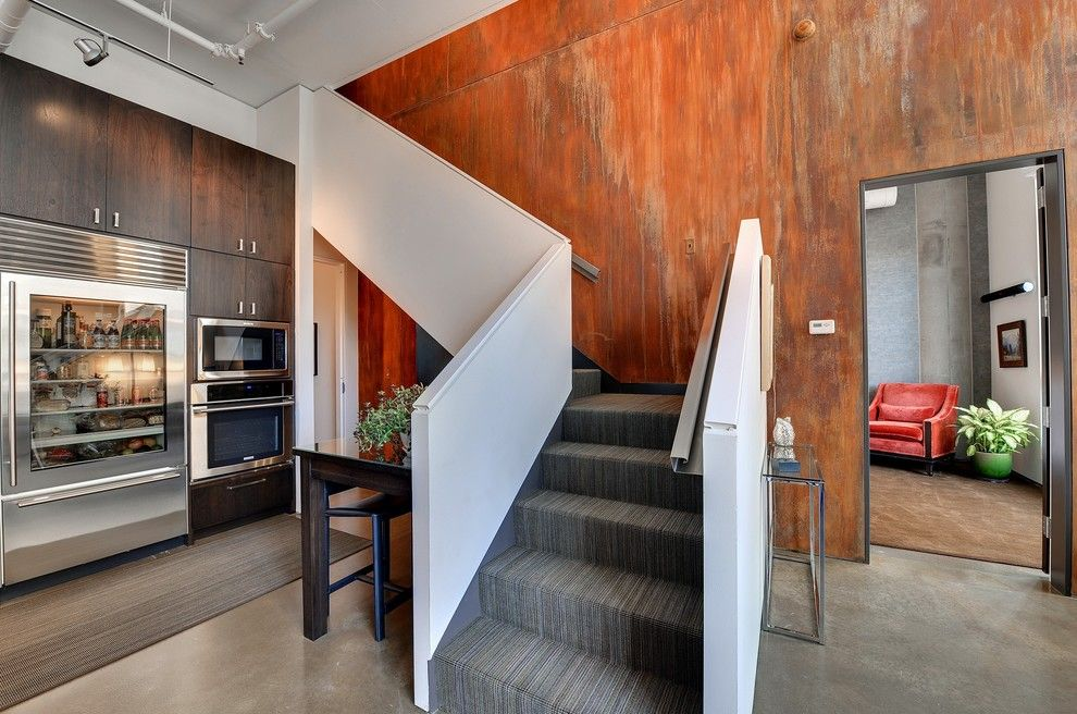 Wall Painting Ideas Texture Staircase Industrial With Carpeted Stairs.  Concrete Floor Dark Stained Wood Dark