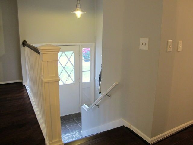 If not a wall where the living room and stairs meet there for Ranch home entryway design ideas