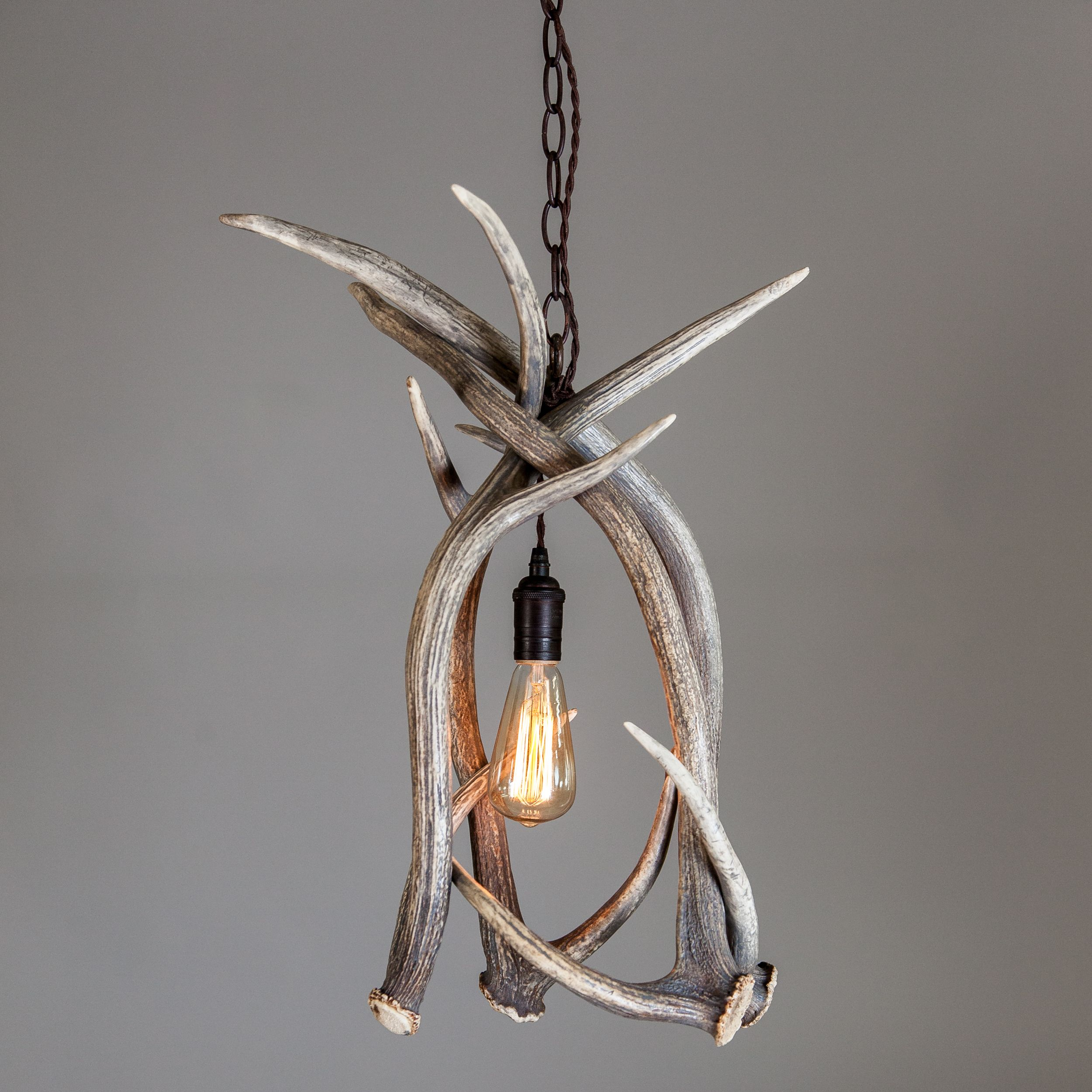 Mountain modern antler chandelier pendant with axis deer shed mountain modern antler chandelier pendant uses axis deer antlers with a soft gray wash rubbed bronze electrical components and an edison style light bulb arubaitofo Images