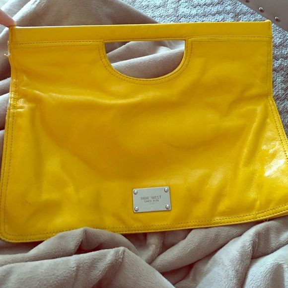 Nine West fold over clutch Bright yellow fold over clutch with magnetic closure. Small markings/scuffs on the front and back. Nine West Bags Clutches & Wristlets