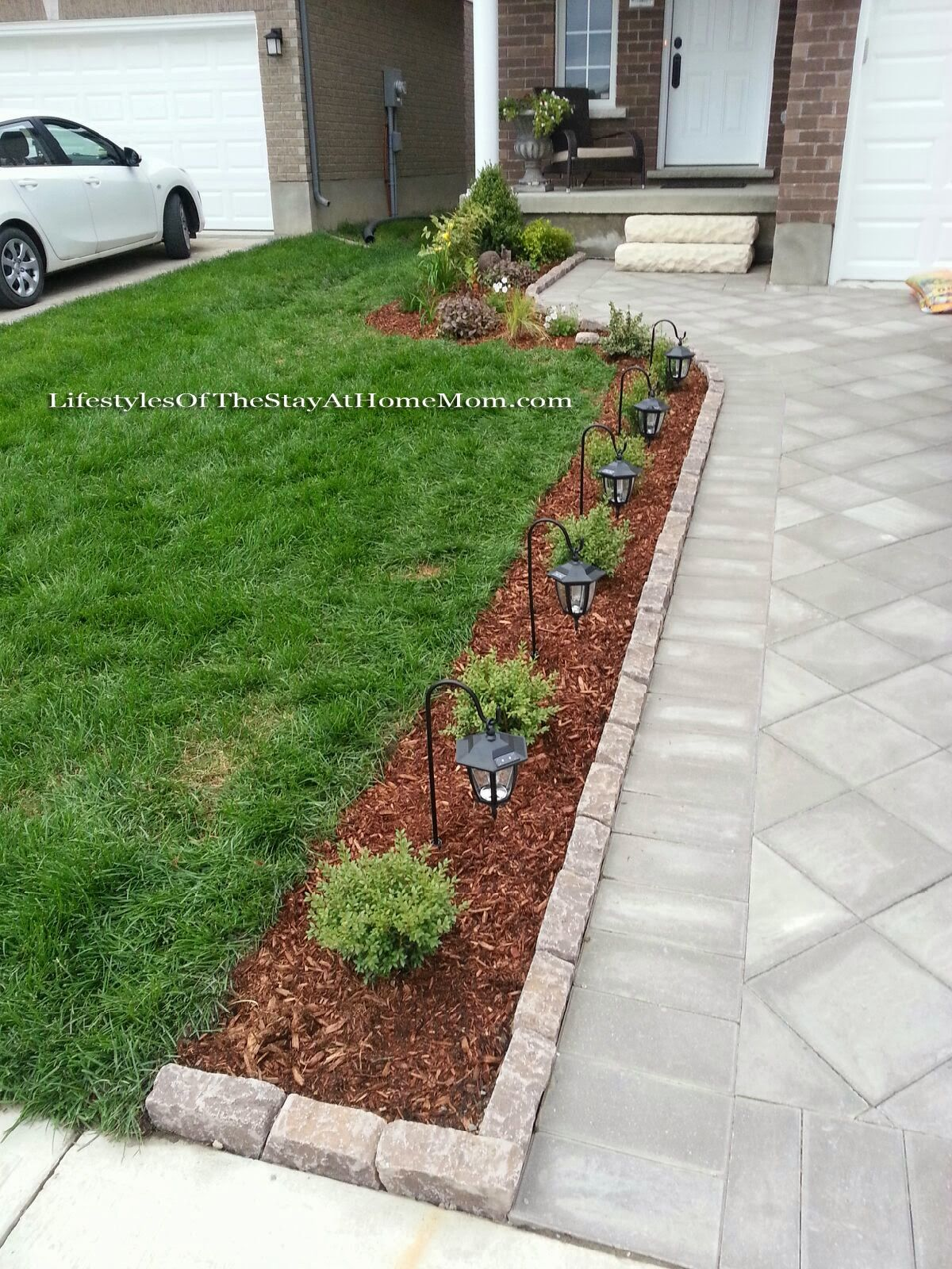 Front yard driveway landscaping ideas  Curb Appeal brick pavers on end to line a small flower bed along