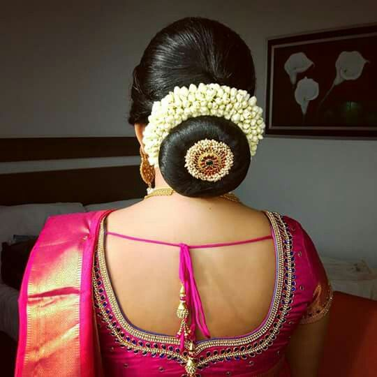What A Beautiful Large Low Bun With Gajra Juda Pin Care However Should Be Taken Before A Indian Bridal Hairstyles Bridal Hair Buns Indian Wedding Hairstyles