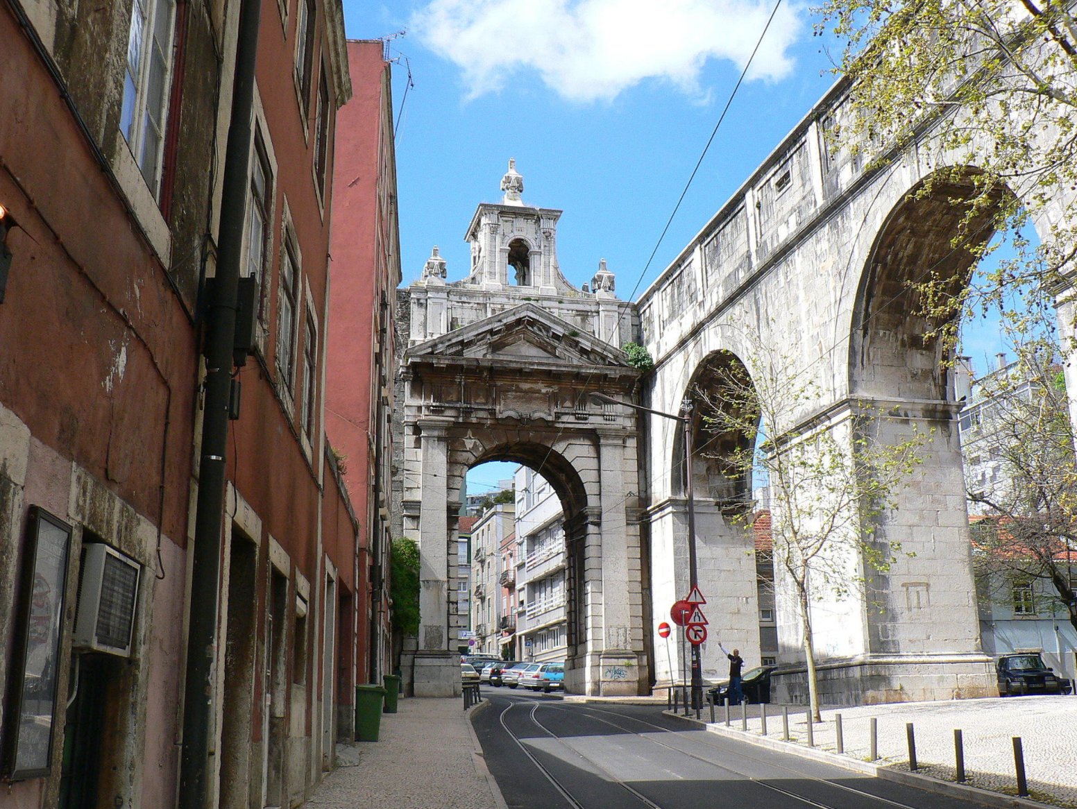 """The Águas Livres Aqueduct (Portuguese: Aqueduto das Águas Livres, pronounced: [ɐkɨˈdutu dɐʃ ˈaɡwɐʃ ˈlivɾɨʃ], """"Aqueduct of the Free Waters"""") is a historic aqueduct in the city of Lisbon, Portugal. It is one of the most remarkable examples of 18th-century Portuguese engineering. The main course of the aqueduct covers 18 km, but the whole network of canals extends through nearly 58 km."""